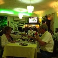 Photo taken at Los Troncos by Guiye E. on 3/2/2012