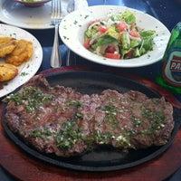 Photo taken at Gaucho's Steak House by Julian N. on 5/25/2012