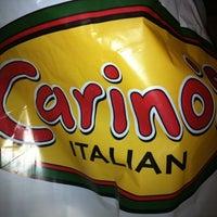Photo taken at Carino's Italian Restaurant by Iris on 12/22/2010