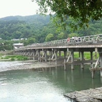 Photo taken at Togetsu-kyo Bridge by Tasuku S. on 6/1/2012