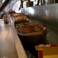 Photo taken at Floating Sushi Boat by Patrick on 5/23/2011
