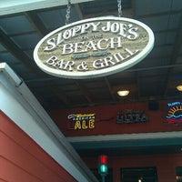 Photo taken at Sloppy Joe's On The Beach by Lori S. on 10/20/2011