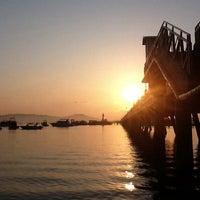 Photo taken at Chalong Bay Pier by Alongod U. on 2/8/2012