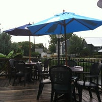 Photo taken at Flatwater Restaurant by Stephanie S. on 7/30/2012