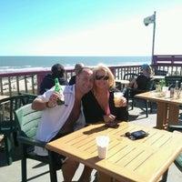 Photo taken at Coconut Joe's Beach Grill by Paul S. on 4/7/2012