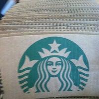 Photo taken at Starbucks by Catherine on 3/27/2012