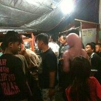 Photo taken at Bubur Ayam Biasa Malam by Prima on 8/20/2012