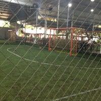 Photo taken at Kuningan Village Futsal & Food Park by Pieters T. on 4/6/2012