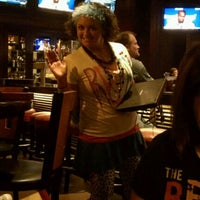 Photo taken at TGI Fridays by Laura G. on 6/15/2012