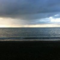 Photo taken at Aberystwyth Beach by Dan S. on 3/17/2012