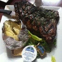 Photo taken at Molly Maguires Pub & Steakhouse by Ryan H. on 8/25/2012