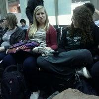 Photo taken at Gate 82 by Kaylee P. on 3/12/2012