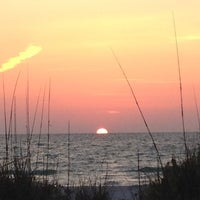 Photo taken at Pass-a-Grille Beach by Tess C. on 4/11/2012