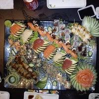 Photo taken at Tomodachi Sushi by Otavio F. on 3/15/2012