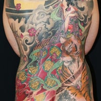 Photo taken at Funhouse Tattoo SD by Leo on 8/30/2012