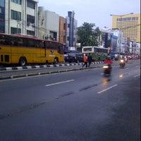 Photo taken at Perempatan Hasyim Ashari by William T. on 4/17/2012