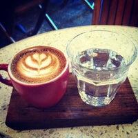 Photo taken at Artifact Coffee by Michael M. on 8/30/2012