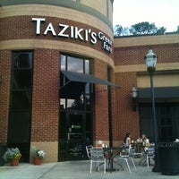 Photo taken at Taziki's Mediterrranean Cafe by Kyle W. on 4/18/2011