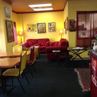 Photo taken at Sacred Grounds Cafe by Travis on 6/20/2012