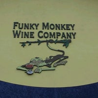 Photo taken at Funky Monkey Wine Company by Amy W. on 1/11/2012