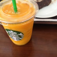 Photo taken at Starbucks by Gokce C. on 8/13/2012