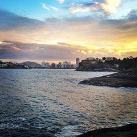 Photo taken at Praia do Canto by Thiago A. on 4/27/2012