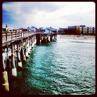 Photo taken at Cocoa Beach Pier by Auro B. on 2/17/2012