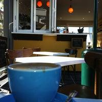 Photo taken at Humming Cafe by Derek A. on 6/25/2012