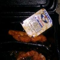 Photo taken at Zaxby's Chicken Fingers & Buffalo Wings by Mijai W. on 12/21/2011