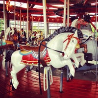 Photo taken at Greenport Antique Carousel by Bob T. on 7/3/2012