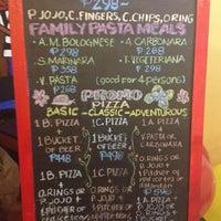 Photo taken at Handuraw Pizza by Trissie C. on 7/27/2012