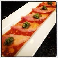 Photo taken at Sake Cafe II by Nicholas J. on 6/3/2012