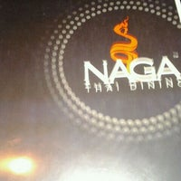 Photo taken at Naga Thai Restaurant by Josh G. on 2/10/2012