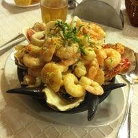 Photo taken at Restaurant La Olla by Hugo P. on 8/7/2012