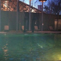 Photo taken at The pool @ Mitchell lofts by Chris O. on 3/6/2011