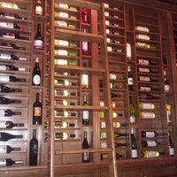 Photo taken at Vino by Karla C. on 12/18/2011