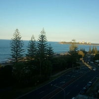 Photo taken at Mooloolaba Beach by Corinne S. on 9/16/2011