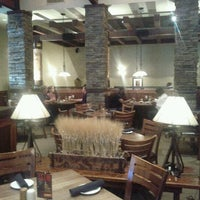 Photo taken at Firebirds Wood Fired Grill by Chris J. on 10/7/2011
