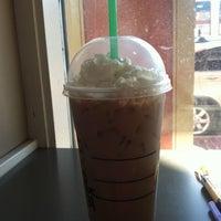 Photo taken at Starbucks by Rebecca G. on 3/12/2011