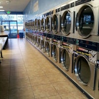 Photo taken at Big Wave Laundromat by Rocio Z. on 1/15/2012