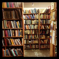 Photo taken at Book Stop Used Books by Genevieve U. on 3/28/2012