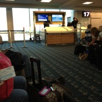 Photo taken at Gate 17 by Alison C. on 3/23/2012