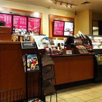 Photo taken at Starbucks by Erwin B. on 12/27/2011