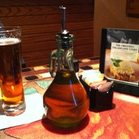 Photo taken at Carrabba's Italian Grill by Amy L. on 7/28/2011