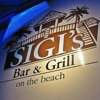 Photo taken at Sigi's Bar & Grill on The Beach by David T. on 5/11/2012