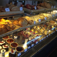 Photo taken at Champagne French Bakery Cafe by Brett C. on 7/8/2012