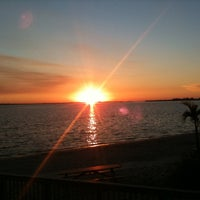 Photo taken at Cape Coral Beach at Yacht Club Community Park by Ryan S. on 12/29/2010