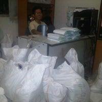 Photo taken at JNE Kawaluyaan by ade b. on 10/22/2011