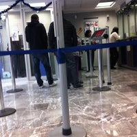 Photo taken at BBVA Bancomer Sucursal by Carlos X. on 1/3/2012