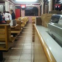 Photo taken at Tacos el Frances by Jorge A. on 1/12/2012